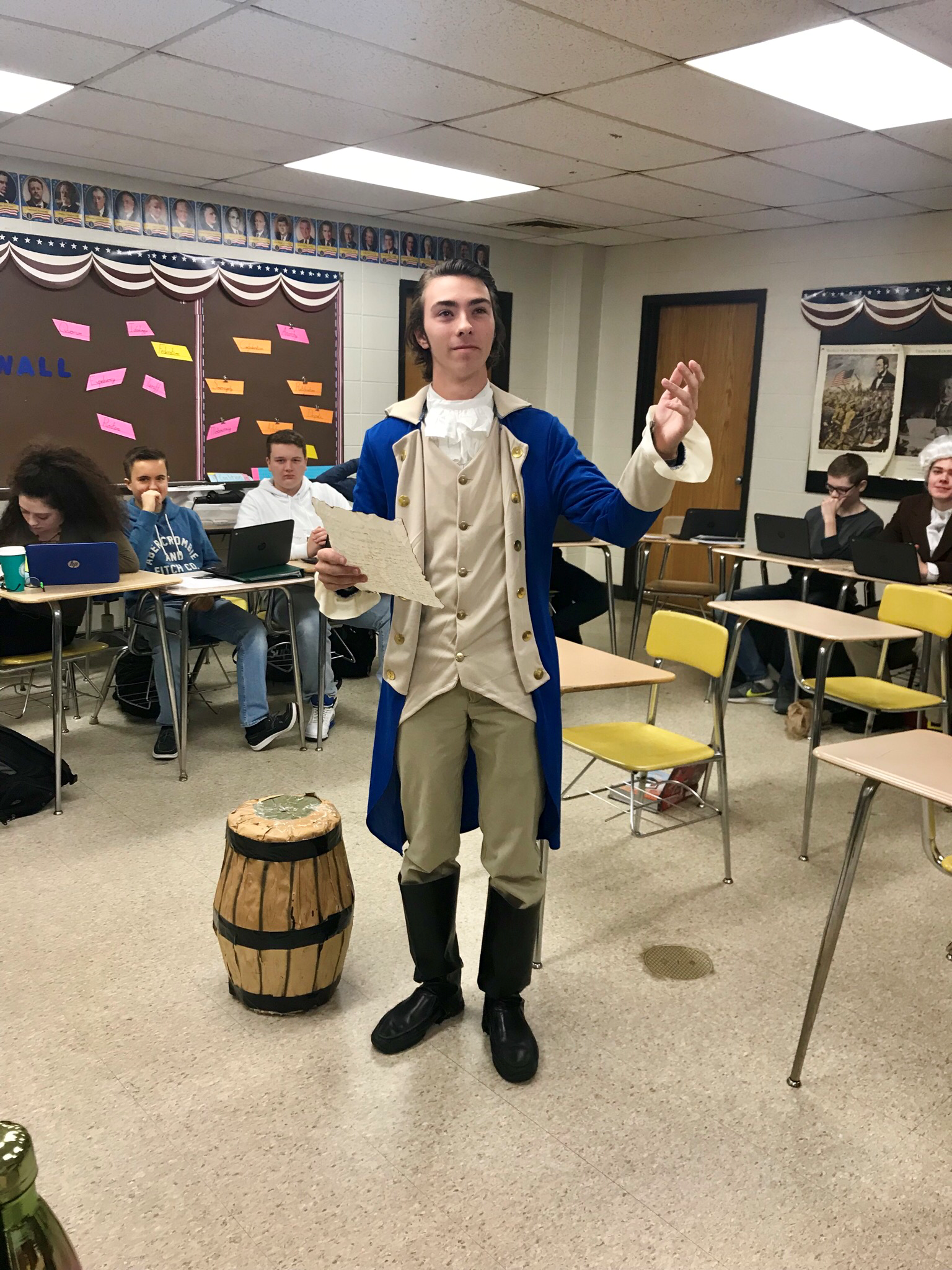 Student portraying Alexander Hamilton and reading a speech