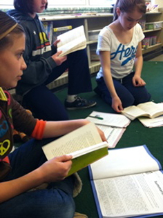 Students in group book discussion