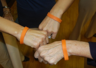 Teachers display Bullying bracelets.