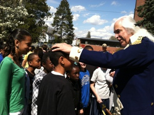 General George Washington visits with students