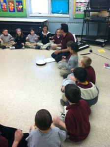 Teacher and students sitting in a circle