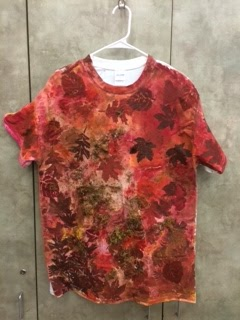 image of student t-shirt which is sponge painted and completely covered in leaf prints