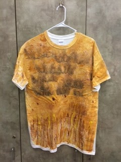 image of student t-shirt which is sponge painted to imitate tall golden grasses