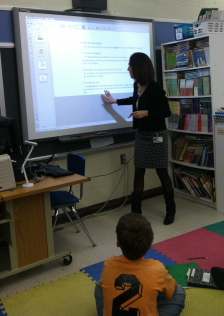 Teacher demonstrates on SmartBoard
